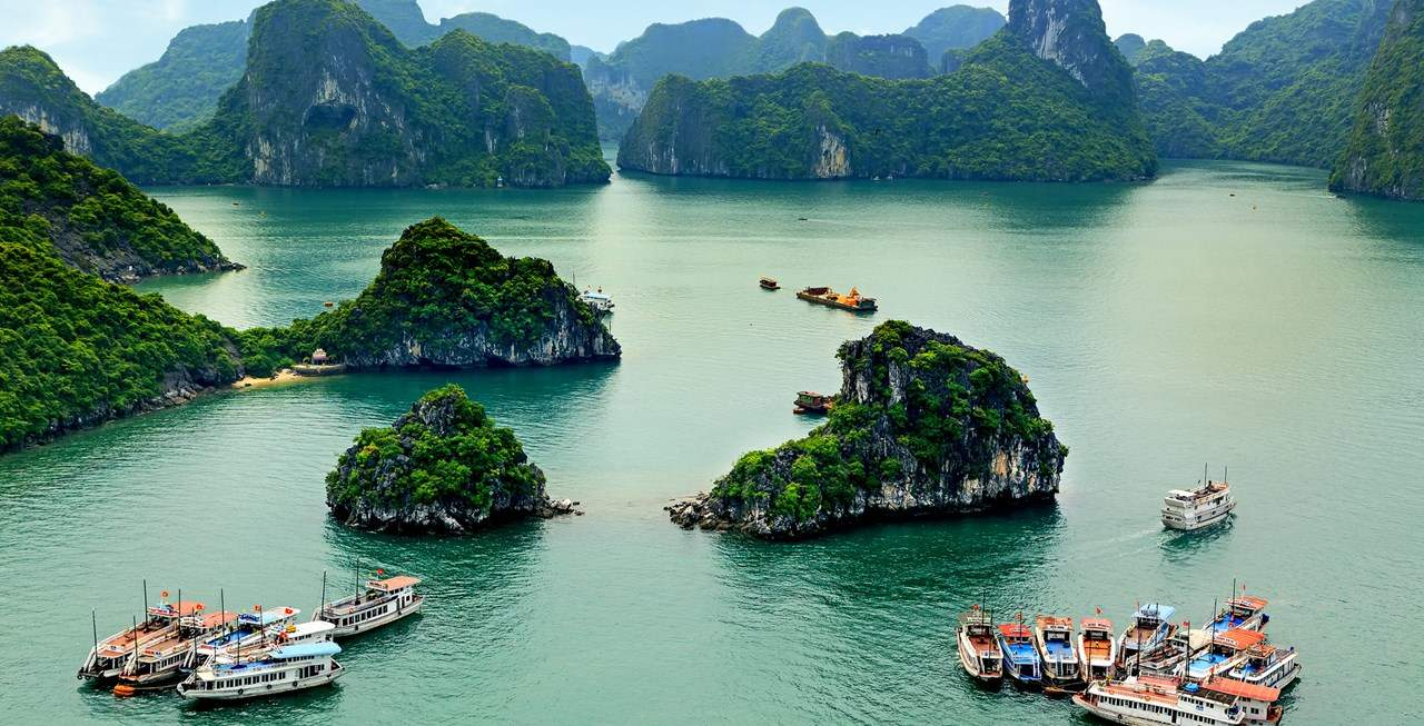 Ha long bay holiday cruises and deserted island beach resorts for backpackers