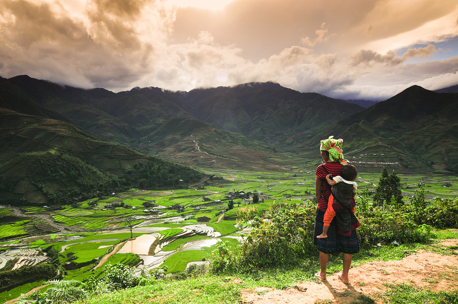 H'mong ethnic minority woman with her son in Mucangchai, Vietnam Southeast Asia Backpacking Budget