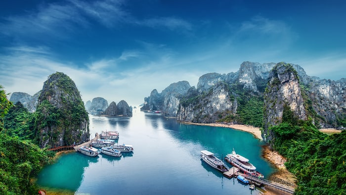 Tourist junks floating among limestone rocks at Ha Long Bay South China Sea Vietnam Southeast Asia ** Note: Soft Focus at 100%, best at smaller sizes